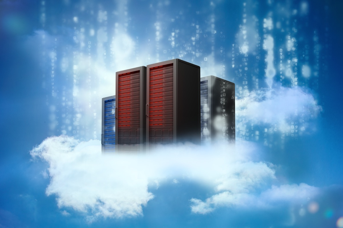 Data servers resting on clouds with falling matrix in blue sky